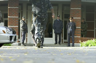 Police and militia at the entrance of the 'yukos' office in zhukovka where searches were resumed in connection with tax evasion and embezzlement charges, october 9, 2003.