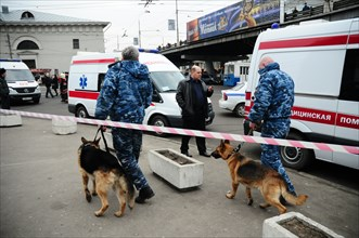 Moscow, russia, march 29, 2010, dog handlers and ambulances outside park kultury metro station, sokolnicheskaya line of the moscow underground, an explosion rocked the metro station at 8,40 during the...