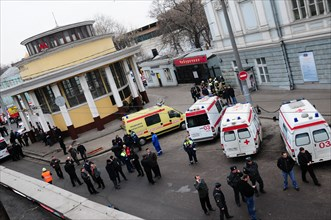 Moscow, russia, march 29, 2010, ambulances and police officers at an entrance to park kultury metro station, sokolnicheskaya line of the moscow underground, an explosion rocked the metro station at 8,...