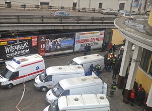 Moscow, russia, march 29, 2010, ambulances and rescue workers outside park kultury metro station, sokolnicheskaya line of the moscow underground, an explosion rocked the metro station at 8,40 during t...