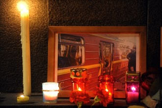 Moscow, russia, march 30, 2010, a photograph of a damaged metro carriage and candles to commemorate victims of the metro bomb explosions, blasts rocked two stations on sokolnicheskaya line of the mosc...