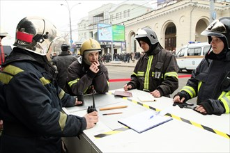 Moscow, russia, march 29, 2010, members of the russian emergencies ministry's mobile emergency response team outside park kultury metro station, sokolnicheskaya line of the moscow underground, an expl...