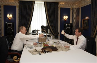 Moscow region, russia, october 1, 2010, president of russia dmitry medvedev (r) and prime minister vladimir putin raise glasses with a sour milk drink (from the ruzskoye moloko dairy company) while ha...