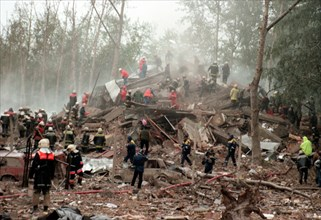 Moscow,russia, september 13, 1999, rescuers and fire-fighters search the rubble left of the apartment block on 6 kashirskoye shosse by the blast that ripped through it at 5 a,m,, on monday, about 40 b...
