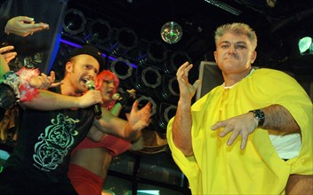 Tv presenter, athlete vladimir turchinsky (r) marks his birthday in the slava night entertainment center, december 5, 2005.
