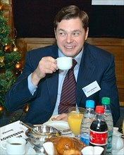 Moscow, russia, november 21, 2006, severstal board chairman alexey mordashov smiles at breakfast with american chamber of commerce in russia representatives, unseen, at the national hotel, moscow.