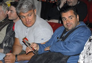 Tv host, athlete vladimir turchinsky, a,k,a, dynamite, (l) and actor sergei rost at moscow's oktyabr cinema where quentin tarantino's highway thriller death proof received its russian premiere, june 5...