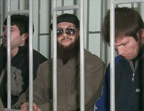 Makhachkala, dagestan, russia, november 15, 2001, chechen terrorist salman raduyev (centre) pictured in the dock, as today, thursday, he and his three accomplices have been put on trial for organizati...