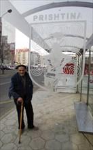 Elderly kosovan at a bus stop in pristina, kosovo, february 25, 2008.