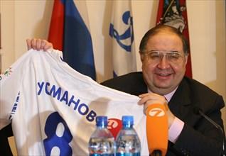 Moscow, russia, february 27, 2008, russian billionaire alisher usmanov who controlls metalloinvest industrial holding company, poses with a jersey bearing his name at a press conference marking metall...