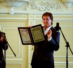Sir paul mccartney, the famous british musician, and a former beatle, receives the award of honorary doctor of music at the st,petersburg conservatory, st, petersburg, russia, 5/03.