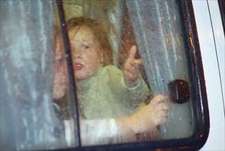 Moscow, russia, 10/23/02: some children (seen in a bus) were allowed to leave the building of the palace of culture of the ball-bearing plant which had been seized by terrorists, on wednesday, accordi...
