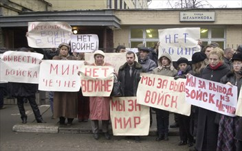 Moscow, russia, october 25 2002: relatives of those taken hostage by a group of terrorists in the building of the palace of culture of the ball-bearing plant pictured picketing with slogans to stop th...