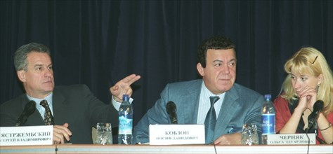 Moscow, russia, october 31 2002, left to right: presidential aide sergei yastrzhembsky, state duma deputy and singer iosif kobzon and an ex-hostage olga chernyak at the press conference about the rece...