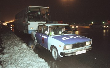 Moscow, russia, november 15 2002: tajik illegal immigrants in a bus escorted by a police car (in pic) on their way to chkalovsky airport for further deportation, the people's courts of khimki and podo...