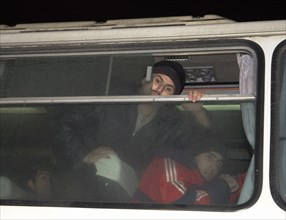 Moscow, russia, november 15 2002: tajik illegal immigrants (in pic) in a bus prior to their departure for chkalovsky airport for further deportation, the people's courts of khimki and podolsk district...
