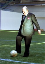 Minsk, belarus, december 8 2002: fifa president joseph blatter kicks a football (in pic) at a ceremony held on sunday to celebrate the opening of a football field with artificial covering, the field w...