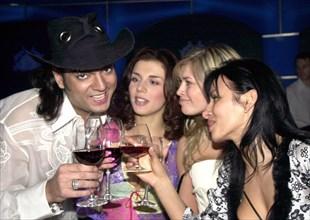 Moscow, russia, april 25 2003, popular singer filipp kirkorov (l) and anna sedakova (l-r), vera brezhneva and nadezhda granovskaya of the via gra group at yesterday's presentation of new album titled ...