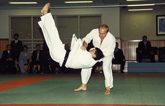 Russian president vladimir putin throwing an opponent at a judo demonstration during his state visit to japan in september 2000, tokyo.