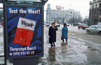 An advertisement for 'west' brand cigarettes on a bus shelter on tverskaya street in moscow, russia.