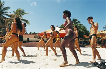 A dance class being held on the beach at a resort on varadero beach, cuba.