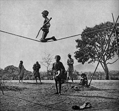 Historical Geography. 1900. India. Balancing feat of a wandering acrobat