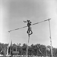 South Asian Indian athlete performing Pole Vault