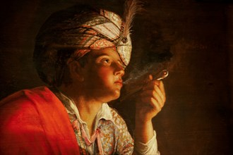 Young man smoking a pipe