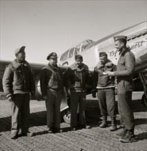 Col. Benjamin O. Davis at Ramitelli, Italy, March, 1945, presenting war bond for best kept A/C