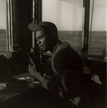 Sgt. William P. Bostic, 301st F.S. in control tower, March 1945