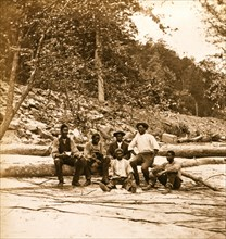 Capt. Ed. Armstrong (Colored) & crew of bateau Tam O'Shanter on beach of New River,