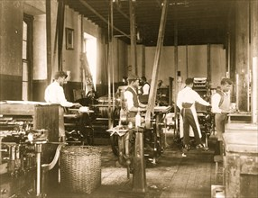 Pressmen at work in printing shop, Hampton Institute