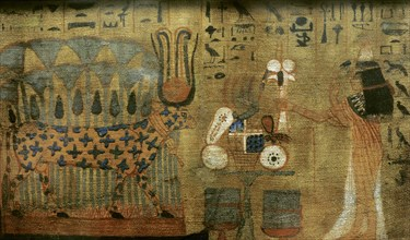 Woman making offerings to the goddess Hathor, cosmic divinity.
