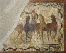 Auriga winner on quadriga (chariot of four-horse). Roman painting. Domus. 4th Century. Merida. Spain.
