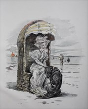 Woman and dog in beach chair on the North Sea