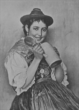 Bavarian woman wearing traditional dress and holding a beer mug