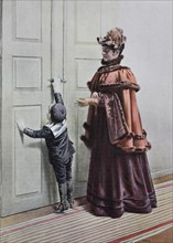 Woman and little boy are standing in front of the door
