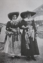 Bride and bridesmaid in the traditional dress of Val Gardena