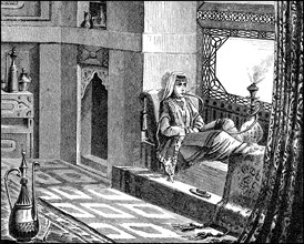 Woman with hookah in the salon in a house at the Tatars
