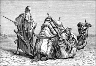 Bedouin family with camel in the Arabian desert