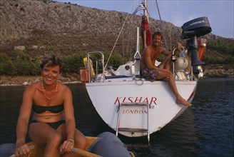 10045188 LEISURE Sailing Yachting Man and woman yachting couple in Greece
