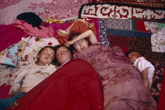 20061225 CHINA Xinjiang Province Altai Mountains Kazakh children asleep in their kigizuy tent made of felt.